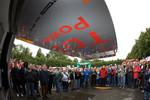 Fans watch as the Audi Sport Team Joest Audi R15 TDI is taken out of the truck at scrutineering