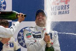 LMP1 podium: Marc Gene celebrates with champagne