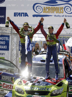 Podium: winners Mikko Hirvonen and Jarmo Lehtinen, Ford Focus RS WRC08, BP Ford Abu Dhabi World Rally Team