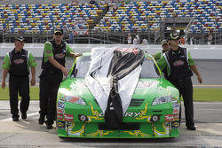 Kyle Busch's crew pushes his car back into the garage after being rained out for qualifying