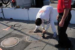 Grinding down the manhole covers in pitlane