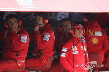 Michael Schumacher, Test Driver, Scuderia Ferrari watches from the Ferrari pit gantry