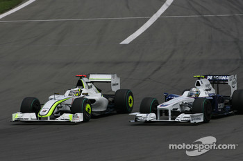 Jenson Button, Brawn GP and Nick Heidfeld, BMW Sauber F1 Team