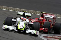 Rubens Barrichello, Brawn GP leads Kimi Raikkonen, Scuderia Ferrari