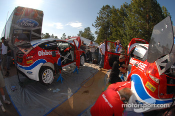 The Ford Fiestas are worked on in the pit area at Pikes Peak