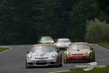 #57 Snow Racing Porsche 911 GT3 Cup: Martin Snow, Melanie Snow, #36 Gruppe Orange Porsche 911 GT3 Cup: Wesley Hoaglund, Bob Faieta