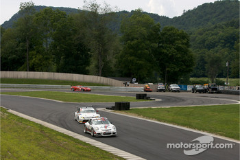 #57 Snow Racing Porsche 911 GT3 Cup: Martin Snow, Melanie Snow leads a group of cars