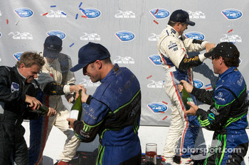 P1 podium: Gil de Ferran, Simon Pagenaud, David Brabham and Scott Sharp celebrate with champagne
