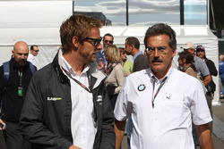 Jenson Button, BrawnGP talks to Dr. Mario Theissen, BMW Sauber F1 Team, BMW Motorsport Director