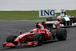 Kimi Raikkonen, Scuderia Ferrari and Giancarlo Fisichella, Force India F1 Team