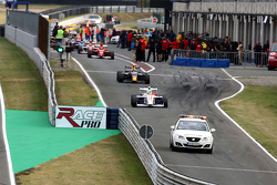 The safety car leads the field through the pitlane following a first corner accident
