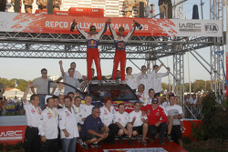 Podium: provisional winners and final second Sébastien Loeb and Daniel Elena celebrate with their team