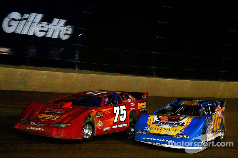 Cruz Pedregon, driver of the #75 races side by side with David Reutimann, driver of the #00