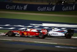Kimi Raikkonen, Ferrari SF16-H and Valtteri Bottas, Williams FW38