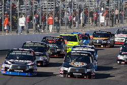 Start: Kyle Busch and Mike Skinner lead the pack