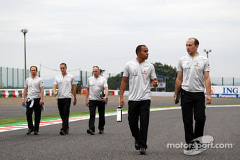 Lewis Hamilton, McLaren Mercedes, walks the track