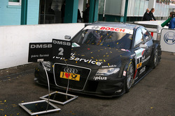 The championship winning car  of Timo Scheider, Audi Sport Team Abt Audi A4 DTM covered in champagne and confetti