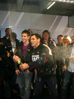 Hans-Jurgen Abt, Teamchef Abt-Audi, spraying champagne in the Abt Audi pitbox