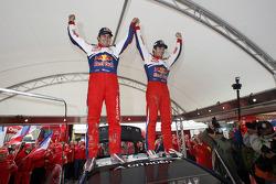 Winners and 2009 WRC champions Sébastien Loeb and Daniel Elena celebrate