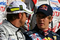 Jenson Button, Brawn GP and Sebastian Vettel, Red Bull Racing