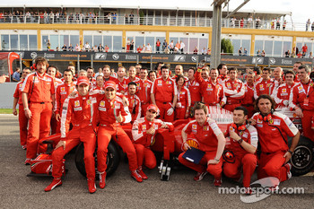 F1 exhibition: Luca Badoer, Felipe Massa, Marc Gene and Scuderia Ferrari team members pose