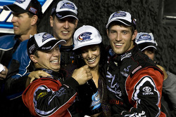 Victory lane: Kyle Busch celebrates win and 2009 Nationwide Series championship with his team and his girlfriend