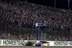Jimmie Johnson, Hendrick Motorsports Chevrolet takes the checkered flag his 4th time NASCAR Sprint Cup Series championship in a row