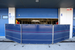 Barriers in front of the Red Bull garage