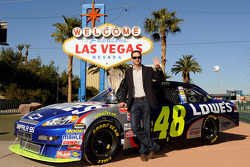 2009 NASCAR Sprint Cup Series Champion Jimmie Johnson poses with the trophy next to the #48 Lowe's Chevrolet