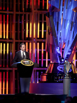 Four time NASCAR Sprint Cup Series Champion Jimmie Johnson accepts the Sprint Cup 2009