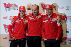 Casey Stoner and Nicky Hayden with Claudio Domenicali