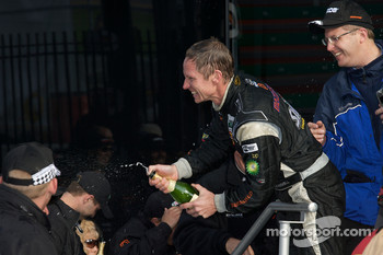 GT podium: David Haskell celebrates with champagne