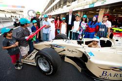 Local children visit the GP2 paddock