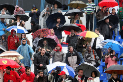 Fans watch in the rain