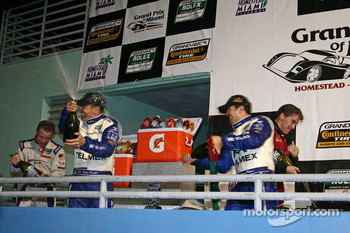 DP podium: class and overall winners Scott Pruett and Memo Rojas celebrate with champagne