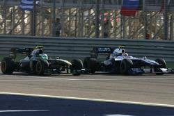 Heikki Kovalainen, Lotus F1 Team and Nico Hulkenberg, Williams F1 Team