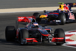 Jenson Button, McLaren Mercedes leads Mark Webber, Red Bull Racing