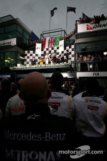 Podium: race winner Jenson Button, McLaren Mercedes, second place Robert Kubica, Renault F1 Team, third place Felipe Massa, Scuderia Ferrari