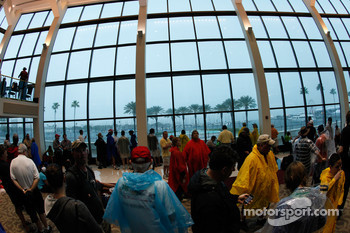 Fans take shelter inside while heavy rain falls outside