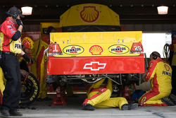 The No. 29 Pennzoil team works on their car after problems occured during the race
