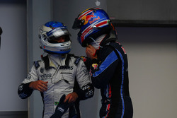 Pole winner Mark Webber, Red Bull Racing with Rubens Barrichello, Williams F1 Team