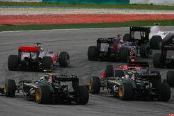 Heikki Kovalainen, Lotus F1 Team and Jarno Trulli, Lotus F1 Team