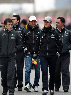 Nico Rosberg, Mercedes GP and Michael Schumacher, Mercedes GP walk the circuit