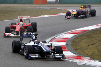 Rubens Barrichello, Williams F1 Team leads Felipe Massa, Scuderia Ferrari