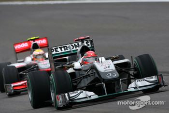 Michael Schumacher, Mercedes GP leads Lewis Hamilton, McLaren Mercedes