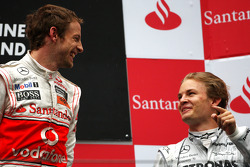Podium: race winner Jenson Button, McLaren Mercedes, with third place Nico Rosberg, Mercedes GP