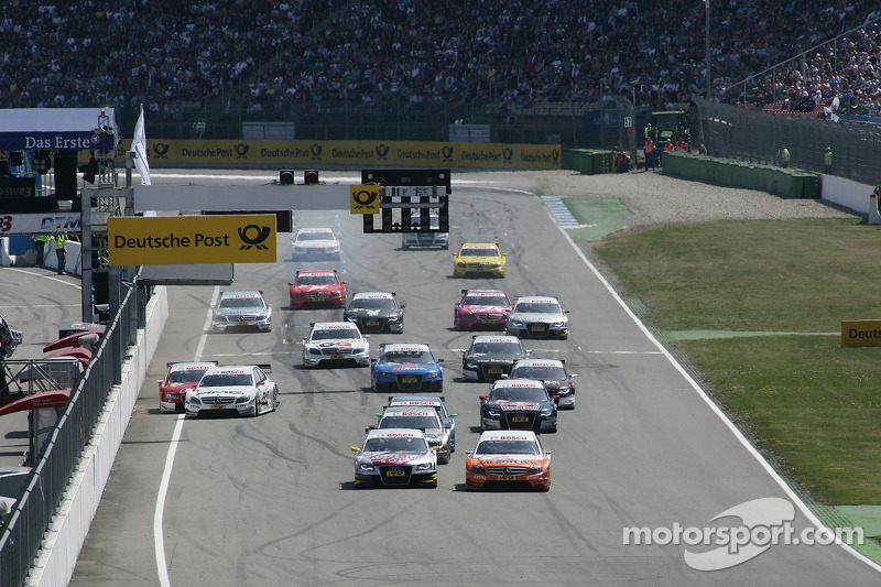 Start: Gary Paffett, Team HWA AMG Mercedes C-Klasse and Martin Tomczyk, Audi Sport Team Abt Audi A4 DTM battle for the lead