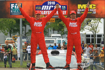 Winner, Katsu Taguchi with co-driver Mark Stacey of MRF Tyres