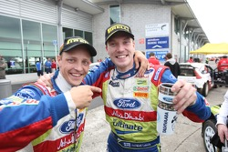 Winner Jari-Matti Latvala celebrates with teammate Mikko Hirvonen