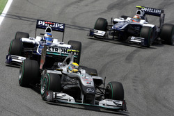 Nico Rosberg, Mercedes GP Petronas leads Rubens Barrichello, Williams F1 Team, and Nico Rosberg, Mercedes GP Petronas